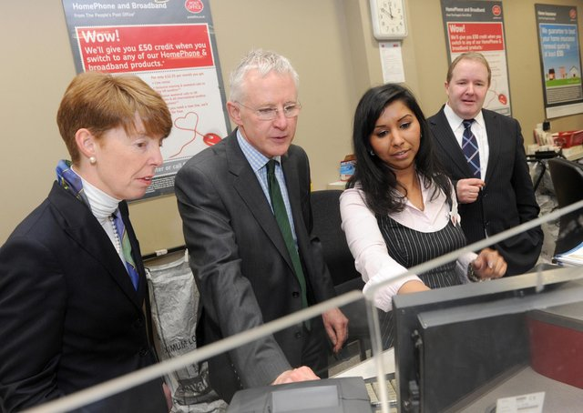 Paula Vennells (left) during a visit to a local post office in 2012.
