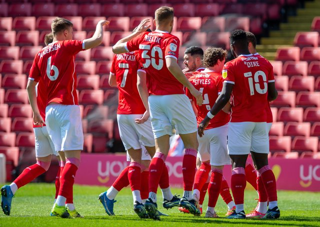RRemarkable ride: Barnsley players celebrate Carlton Morris's controversial goal against Rotherham on Saturday that eventually sealed a play-off spot. (Picture: Bruce Rollinson)