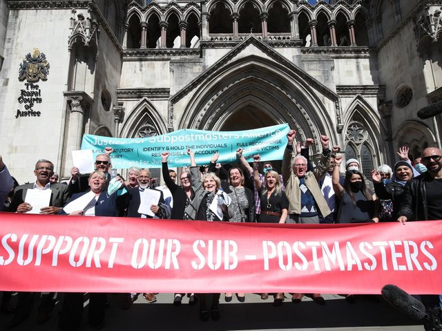 Former postal workers celebrating outside the Royal Courts of Justice in London after their convictions were overturned by the Court of Appeal.