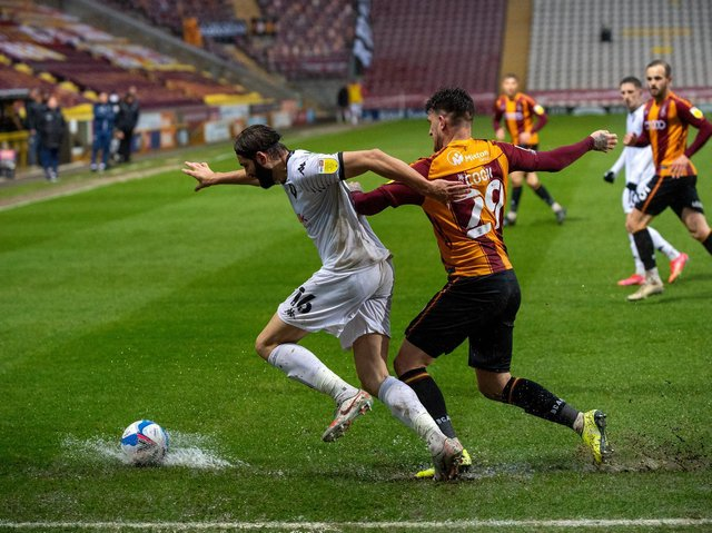 Action from Bradford City's home game with Salford City at a wet Valley Parade. Picture: Bruce Rollinson.