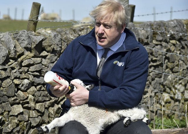 Boris Johnson during a farm visit to Derbyshire where he met NFU chairman Minette Batters.