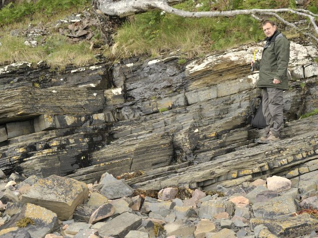 Pictured, Professor Charles Wellman, one of the lead investigators of the research, from the University of Sheffield at Loch Torridon, where the fossil was discovered. Photo credit: The University of Sheffield