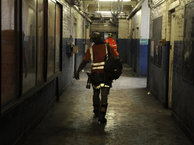 A miner walks to the showers after his last shift as UK deep coal mining comes to an end in 2015 at Kellingley Colliery. Image: Bruce Rollinson.