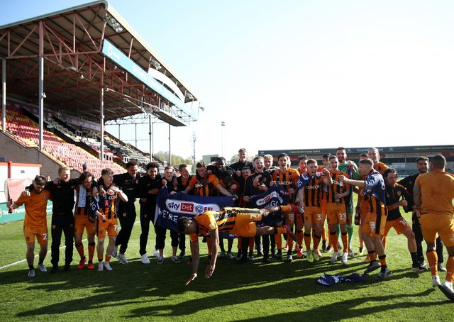 Hull City's players celebrate promotion to the Championship at Lincoln. Picture: Tim Goode/PA