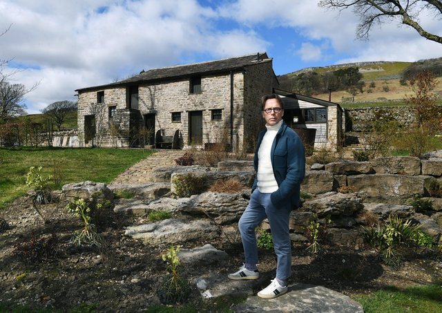 Artist and former fashion designer Graeme Black, pictured outside the Yorkshire Dales barn he has converted into his studio. 