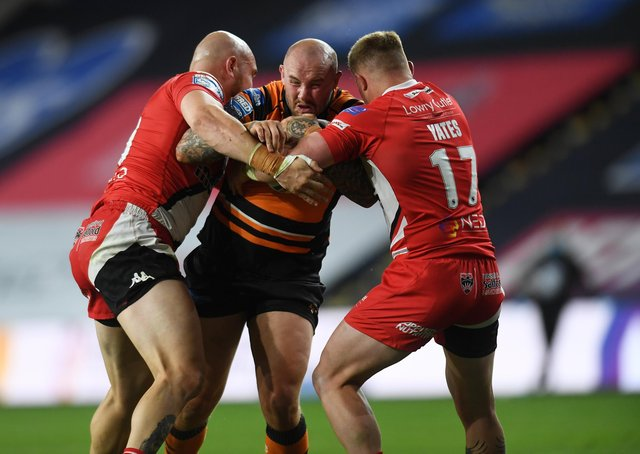 Milestone: Nathan Massey, centre, pictured playing against Salford last season, will rack up his 250th Tigers appearance against the same opposition tonight. (Picture: Jonathan Gawthorpe)