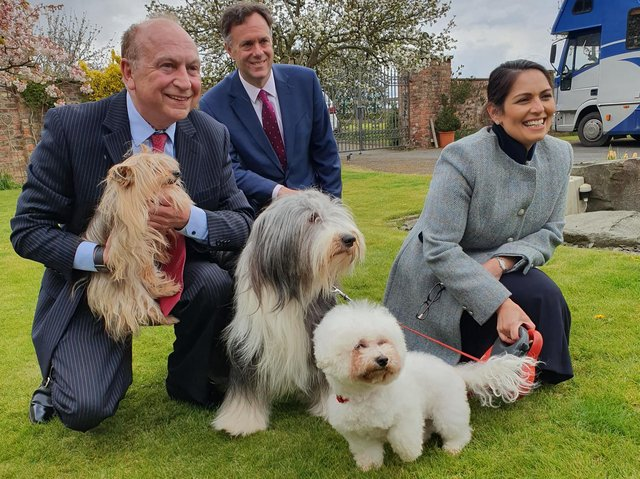 Home Secretary Priti Patel (right) on a visit to a kennels in York today. She was there in support of PCC candidate Philip Allot (left) and was joined by York MP Julian Sturdy (centre)