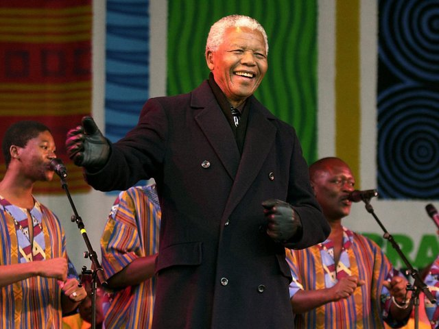 Former South African president Nelson Mandela joins in the dancing on stage with Ladysmith Black Mambazo at the Millennium Square in Leeds where he was made an honorary freeman during his first visit to the north of England. PA Archives