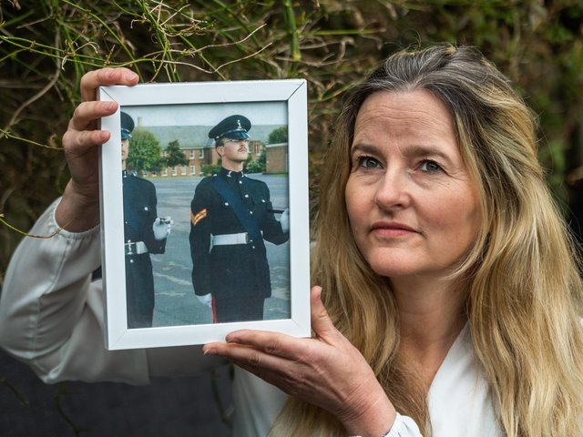 Lisa Craig-Crawford with a picture of her husband Steve, who died in 2017. Picture: James Hardisty