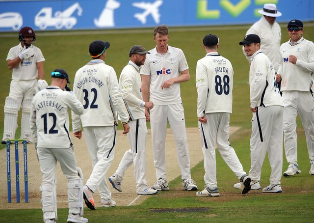 Success: Yorkshire captain Steve Patterson is congratulated for the dismissal of Ben Curran. Picture: Dave Williams