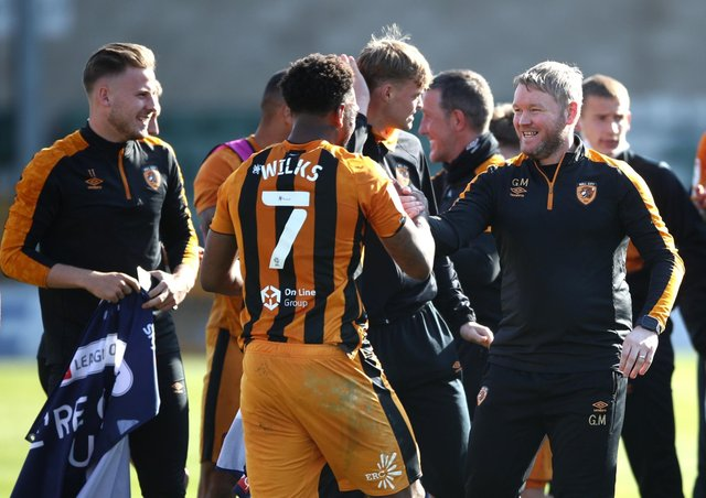 Mission accomplished: Mallik Wilks, Grant McCann and Hull City celebrated promotion to the Championship last week. (Picture: PA)