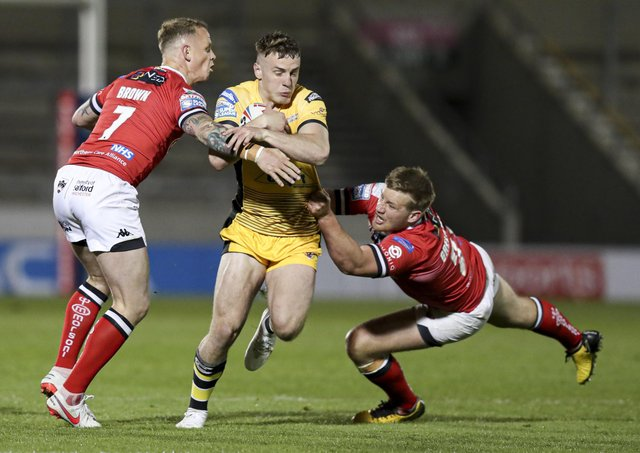 Castleford Tigers' Jake Truman Sid tackled by Salford Red Devils' Kevin Brown and James Greenwood. Picture: Paul Currie/SWpix.com
