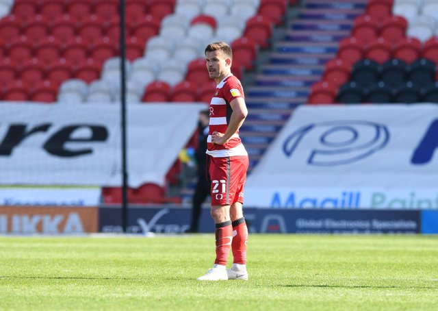 Doncaster's Andy Butler cuts a lonely figure after the defeat by Fleetwood. Picture: Howard Roe/AHPIX LTD