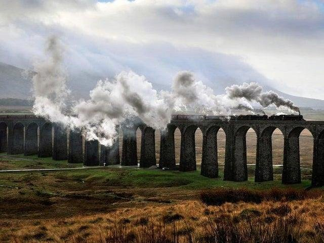 The Winter Cumbrian Mountain Express steams over the Ribblehead Viaduct on the Settle Carlisle line. Picture by Bruce Rollinson.