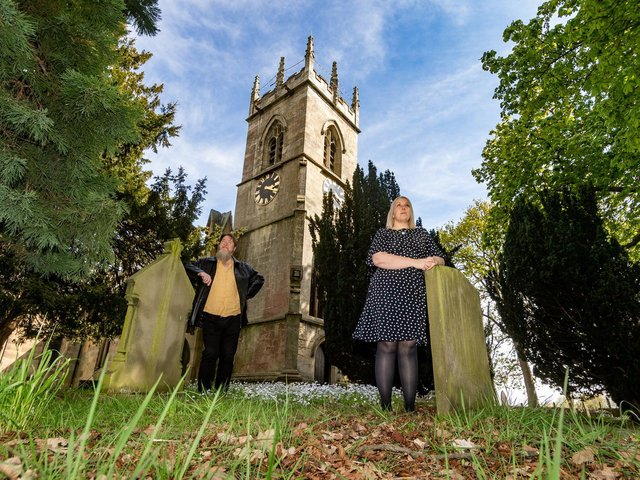 Pictured (left to right) Victoria Ryves, a curator, from Heritage Doncaster, with Nick Crouch, a researcher for Heritage Doncaster's Changing The Record project, in the grounds of St Michaels Church, Rossington, near Sheffield. Image James Hardisty