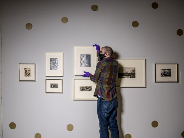 Curator Ashley Gallant with Cecil Beaton's Bright Young Things hung ready  for the reopening of the Millennium Gallery in Sheffield. The new exhibition comes direct from the National Portrait Gallery, London. Picture Tony Johnson