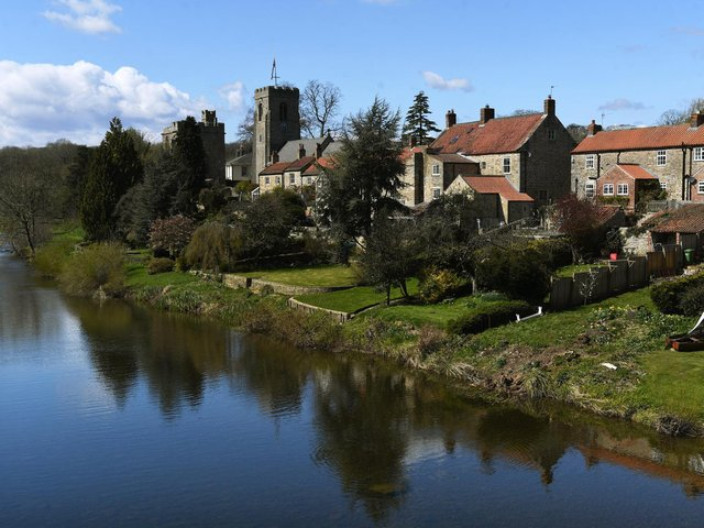 St Nicholas Church and The Marmion Tower stand on the banks of the River Ure, in the village of West Tanfield, near Ripon. Picture: Jonathan Gawthorpe