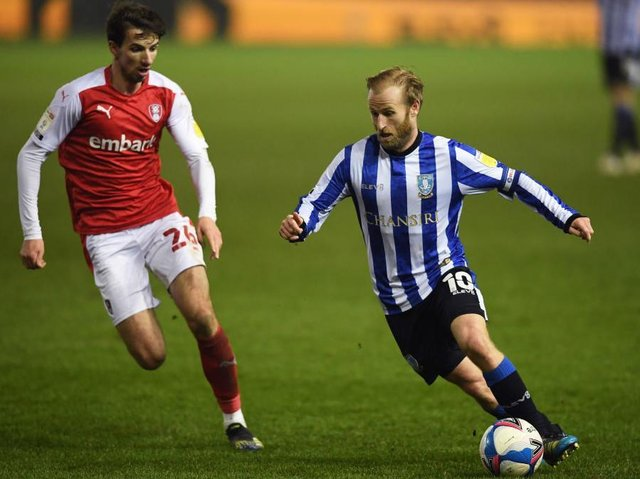 UNCERTAINTY: Rotherham United's Dan Barlaser and Sheffield Wednesday's Barry Bannan both go into the final week of the season not knowing what division their club will be in next season