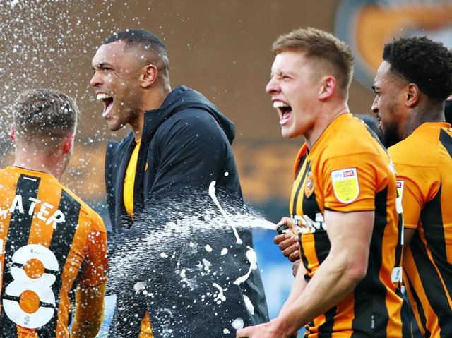 Hull City players celebrate after beating Wigan Athletic 3-1 to wrap up the League One title. Pictures: Getty Images