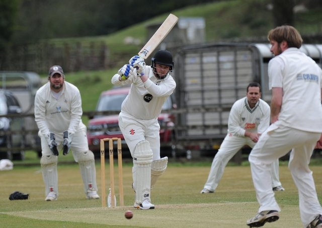 On the drive: Lewis Foxton helping Pateley Bridge to 248 in the 61-run Nidderdale League win at home to Goldsborough. Picture: Gerard Binks