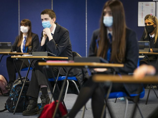 Pupil's at AB's school have been 'required' to wear facemasks, a court was told, but the trust running the school said students were 'encouraged' to wear them