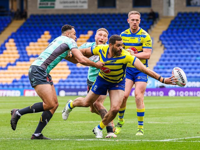 Warrington Wolves' Greg Inglis tries to flick out a pass against Hull KR (ALEX WHITEHEAD/SWPIX)