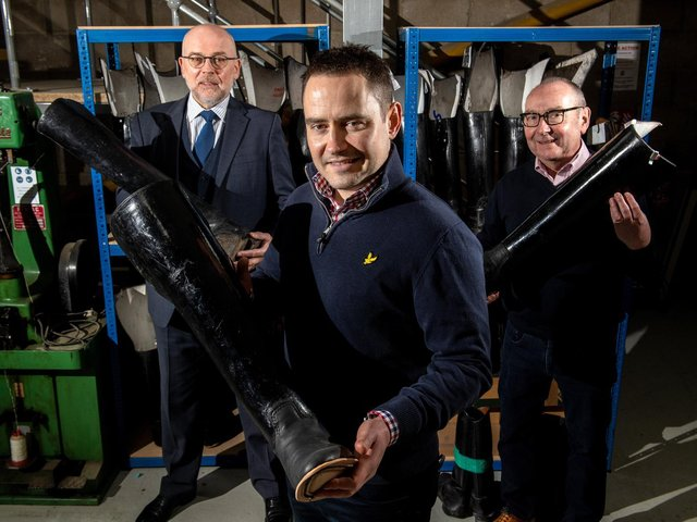 Directors Chris Wilson, Tom Forbes and Gerald Forbes with boots from the Household Cavalry at the workshop in Leeds.  (Bruce Rollinson).
