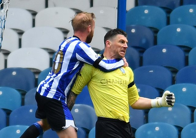 Saved: Sheffield Wednesday's Barry Bannan celebrates with goalkeeper Keiren Westwood for his penalty save.
