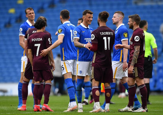 Hard luck: Brighton defender Ben White, who spent last season on loan at Leeds United, shakes hands with Tyler Roberts after the Seagulls' 2-0 win. (Photo by Ben Stansall - Pool/Getty Images)