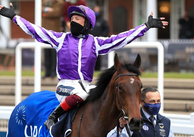 Frankie Dettori celebrates the Qipco 1000 Guineas win of Mother Earth.