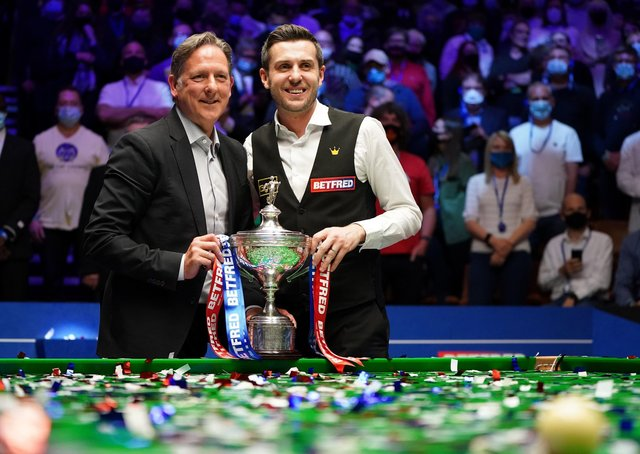 Helping hand: Mark Selby, right, poses with coach Chris Henry after winning the title at The Crucible. (Picture: Zac Goodwin/PA)
