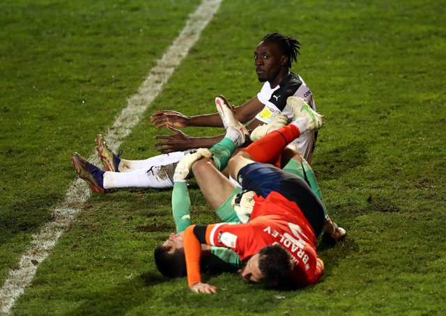 Rotherham United's Freddie Ladapo looks on as Luton Town's Sonny Bradley and Simon Sluga collide whilst defending. Pictures: PA.