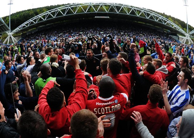 Love-in: Huddersfield and Barnsley fans celebrate survival together. Picture: Mark Bickerdike.