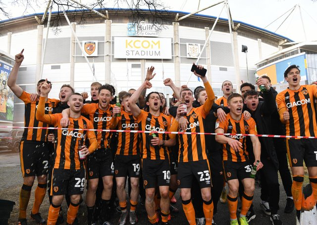 Just champion: Hull City players run out to celebrate outside the KCOM Stadium with their fans, after becoming champions. Picture : Jonathan Gawthorpe