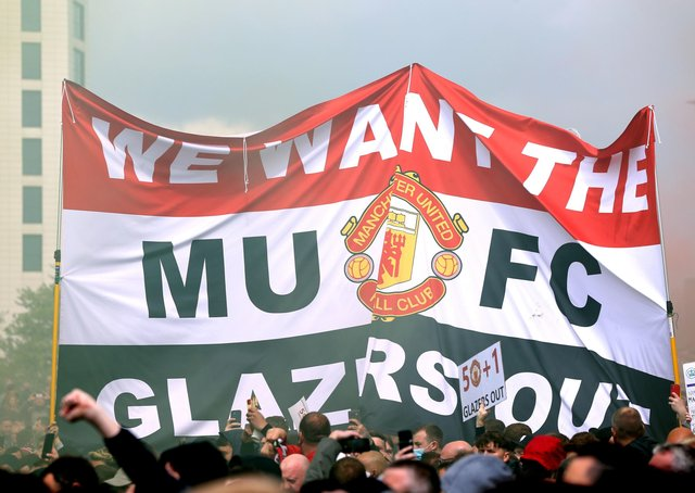 Demonstrating: Fans hold up a banner as they protest against the Glazer family, owners of Manchester United, at Old Trafford.