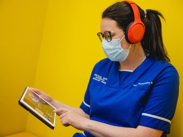 Nurse Sheleen Armstrong, 39, a sister working as part of the critical care outreach team, trialling MediMusic.