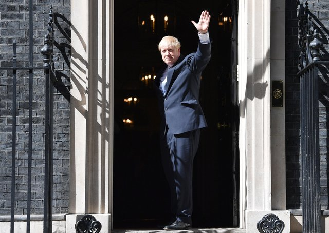 """Boris Johnson enters 10 Downing Street for the first time as Prime Minister moments after promising a """"clear plan"""" to reform social care."""