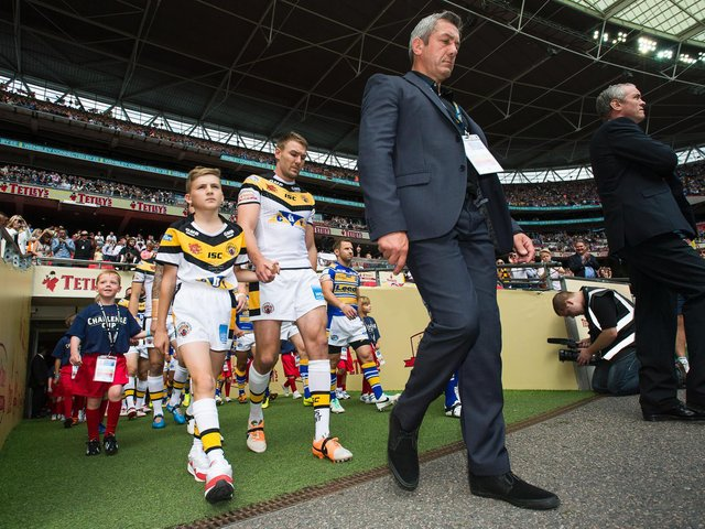 Daryl Powell leads his Castleford Tigers team out with captain Michael Shenton ahead of the 2014  Challenge Cup final against Leeds Rhinos at Wembley. (ALLAN MCKENZIE/SWPIX)