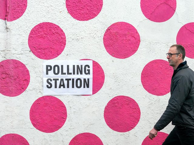 A man walks past a polling station in the Bank View Cafe, Sheffield
