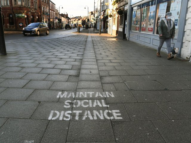 A painted message in Selby which urges people to maintain social distancing