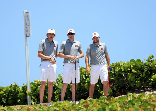 On course: Barclay Brown, Mark Power, and Alex Fitzpatrick walk down the 18th hole during practice at Seminole Golf Club. (Picture: R&A Media / Getty Images)