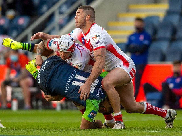 Huddersfield Giants' Kenny Edwards is tackled by St Helens. (BRUCE ROLLINSON)