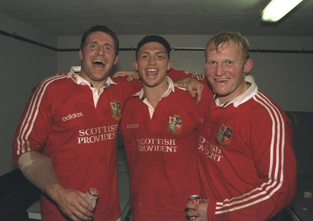 PARTY TIME: Alan Tait, left, Matt Dawson and Neil Jenkins celebrate the British Lions' first Test win over South Africa, winning 25-16 at Newlands in Cape Town in June 1997. Picture: GettyImages/Alex Livesey /Allsport