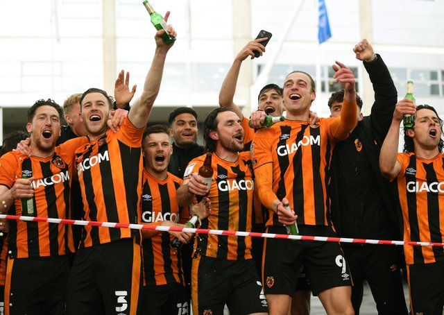 Hull's players run out of the KCOM Stadium to celebrate with their fans. (Picture: Jonathan Gawthorpe)