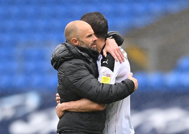 Consoling: Paul Warne embraces Richard Wood. Pictures: Getty Images.