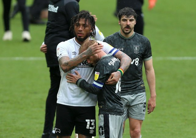 Bitter end: Sheffield Wednesday's Barry Bannan is consoled by Derby County's Colin Kazim-Richards. Picture: PA