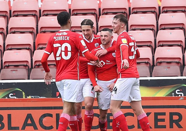 Barnsley's Conor Chaplin (centre) celebrates scoring their second goal against Championship champions Norwich City at Oakwell. Picture: John Clifton/Sportimage