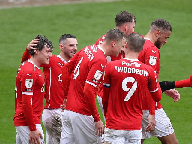 Barnsley players celebrate their second goal against Norwich City at Oakwell. Pictures: Getty Images