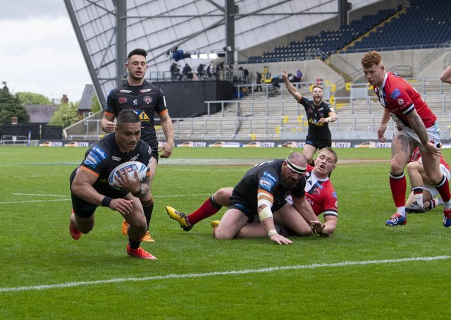 Tigers' Peter Matautia dives over to score their second try. Picture: Tony Johnson