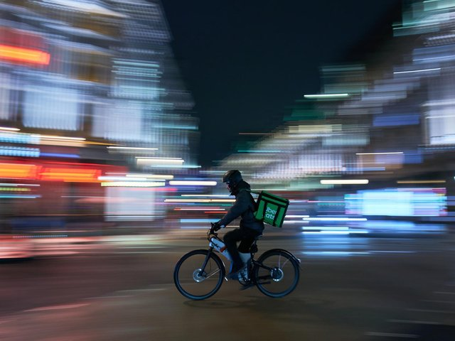 Library image of an Uber Eats delivery rider. Wendy's will be partnering with Uber Eats to provide delivery options.